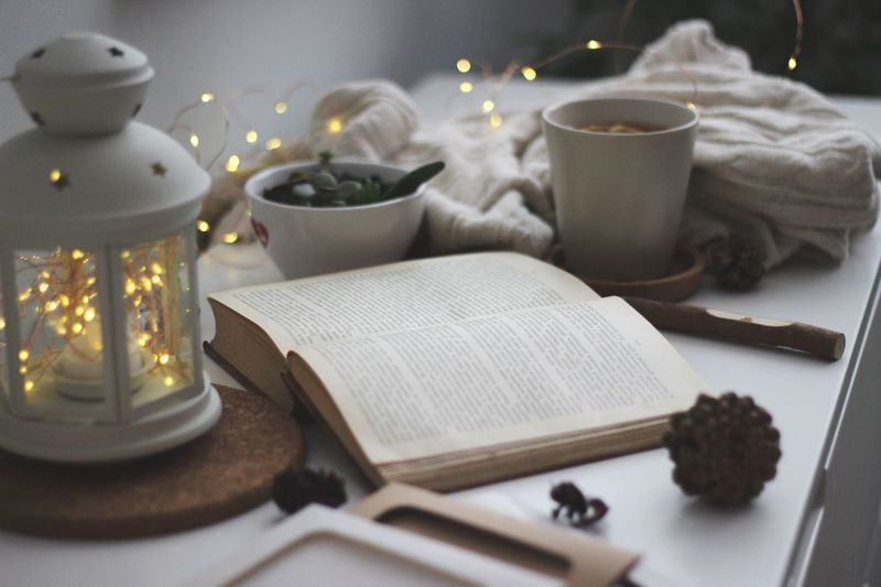 Table Indoors  No People Candle Food And Drink Still Life Publication Selective Focus Food High Angle View Drink Mug Cup Book Close-up Spirituality Paper Bowl Illuminated Religion