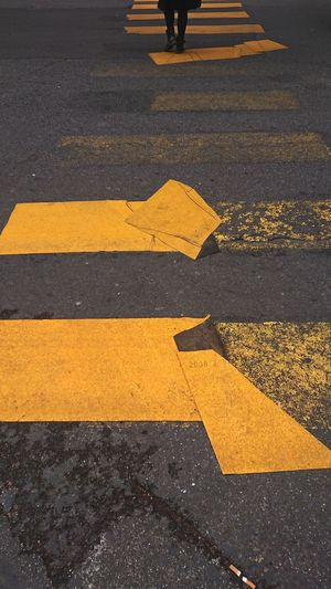 High Angle View Of Yellow Crossing Sign On Road