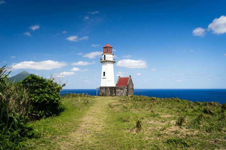 Tayid lighthouse in Batanes - Philippines Cloud Green Lighthouse Philippines Travel Traveling Architecture Basco Batanes Blue Blue Sky Building Lighthouse Outdoors Protection Safety Sky Tayid Lighthouse Tourism Tower Travel Destinations Water