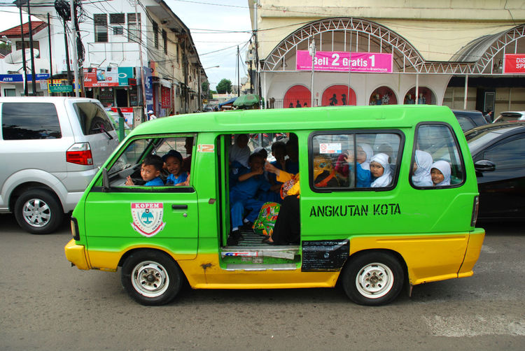 """""""angkot"""" indonesian famous local transportation Angkot Architecture Bogor Building Exterior Built Structure City Day EyeEmNewHere INDONESIA Land Vehicle Men Mode Of Transport Outdoors People Public Transportation Real People Road Sky The Photojournalist - 2017 EyeEm Awards The Street Photographer - 2017 EyeEm Awards Transportation"""