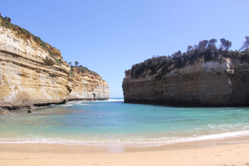 Great Ocean Road Beach Beauty In Nature Blue Clear Sky Cliff Coastal Feature Coastline Day Fossil Geology Horizon Over Water Landscape Nature Outdoors Rock - Object Rock Face Rock Formation Rocky Coastline Sand Scenics Sea Tranquil Scene Travel Destinations Vacations Water