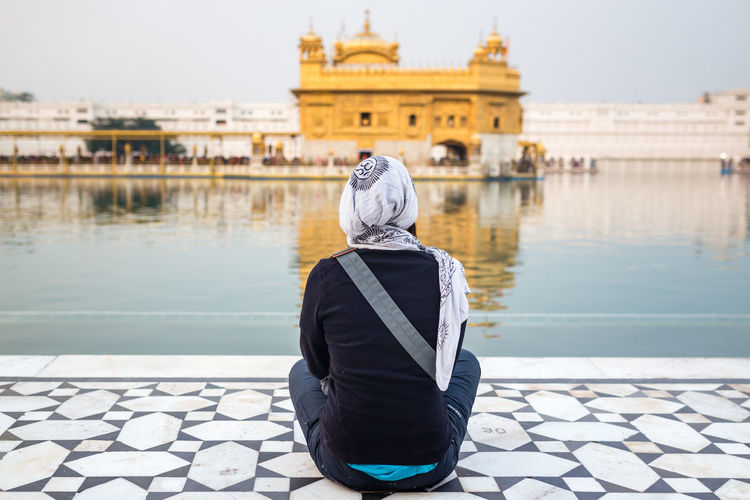 One woman sitting in front of the Golden Temple, Amritsar, India Amritsar Architecture Girl Golden Golden Temple Gurdwara Guru India Indian Meditation Outdoors People Rear View Sahib Sikh Sikh Temple Sikhism Sitting Temple Tourism Tourist Attraction  Travel Destinations Vacations Woman The Traveler - 2018 EyeEm Awards
