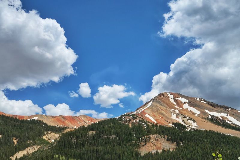 Low angle landscape of red topped mountains in Colorado Million Dollar Highway Colorful Nature Colorado Mountains And Sky Cloud - Sky Sky Beauty In Nature Day Nature Plant Mountain Scenics - Nature No People Environment Landscape Land Low Angle View Tranquility Tranquil Scene Outdoors
