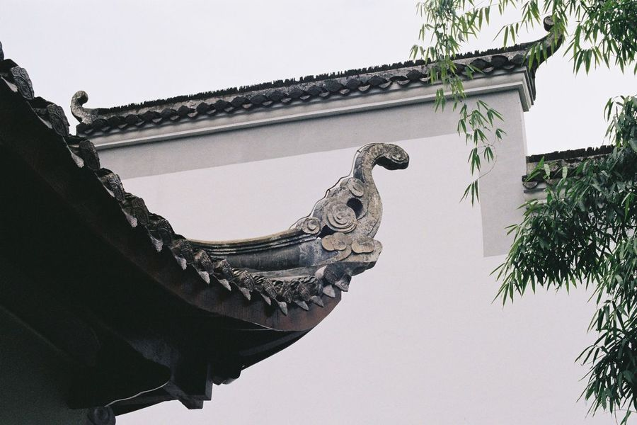 Ae-1 Film Canon Architecture Low Angle View Built Structure Roof Building Exterior Clear Sky Eaves Day Animal Representation Statue Outdoors Sculpture No People Gargoyle Traditional Building Place Of Worship Dragon Sky Chinese Dragon