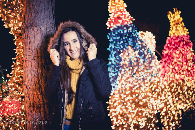 Beautiful teenager with christmas lights at background Young Adult Young Women Women Woman Christmas Adult Teenager Beauty In Nature Beautiful Face Winter Clothes Outdoors Cute Fashion Girl Architecture Smile Smiling Urban Looking At Camera Front View Illuminated Warm Clothing One Person Night Standing Happiness Real People Beautiful Woman
