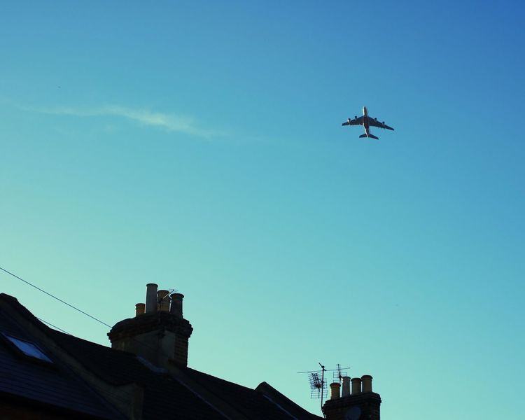 Flying Low Angle View Airplane Transportation No People Sky Outdoors Air Vehicle Day Heathrow Airport Runway Air Traffic  Building Exterior Roof Ariel My Year My View Flying High The Architect - 2017 EyeEm Awards EyeEm LOST IN London Breathing Space Investing In Quality Of Life