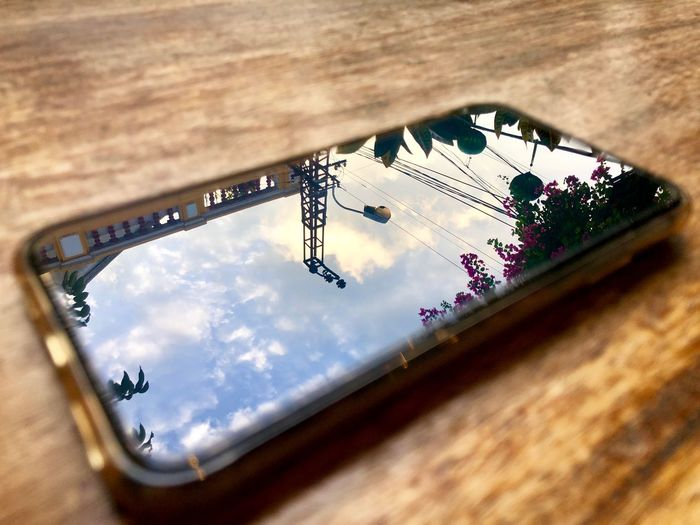 High angle view of cloudy sky seen through glass on table