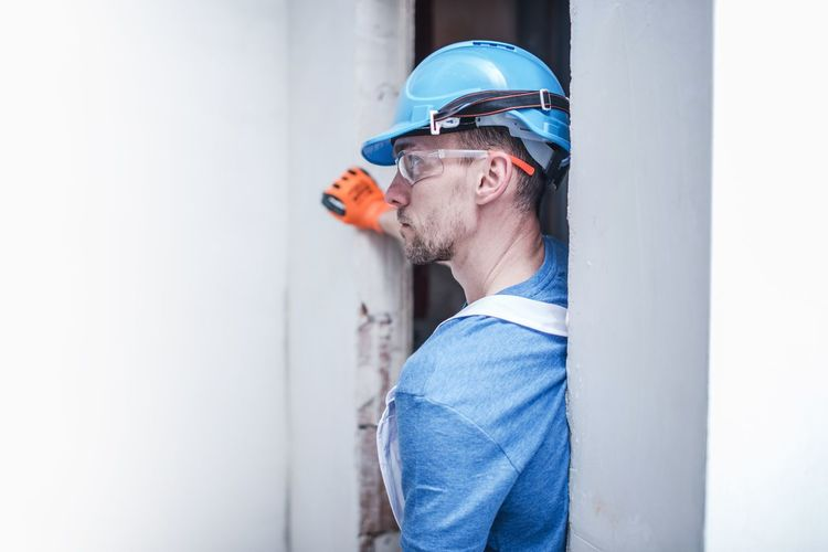 Man wearing helmet while working