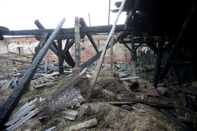 Old rusty railroad tracks on field against sky
