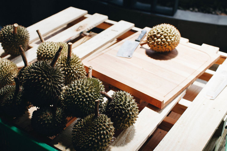 High angle view of durian fruits on wood
