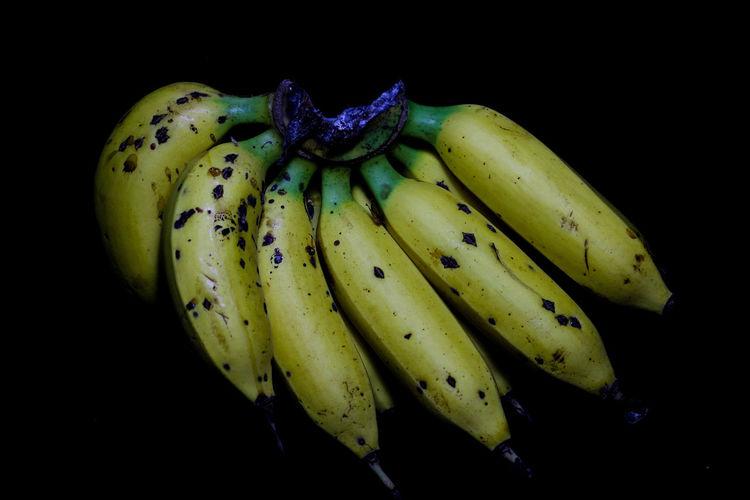 Close-up of banana against black background