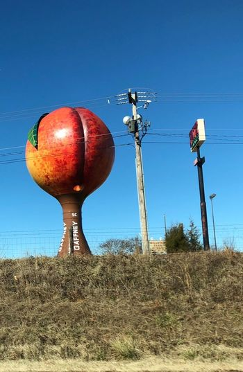 Giant Peach Clear Sky Outdoors Low Angle View Day Field No People Blue
