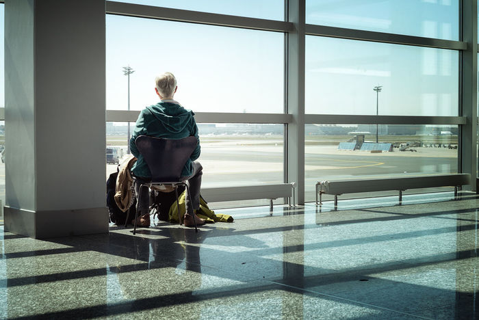 Airport Airport Departure Area Airport Photography Airport Terminal Airport Waiting Airportlife Indoors  One Person Real People Sitting Sunlight Window