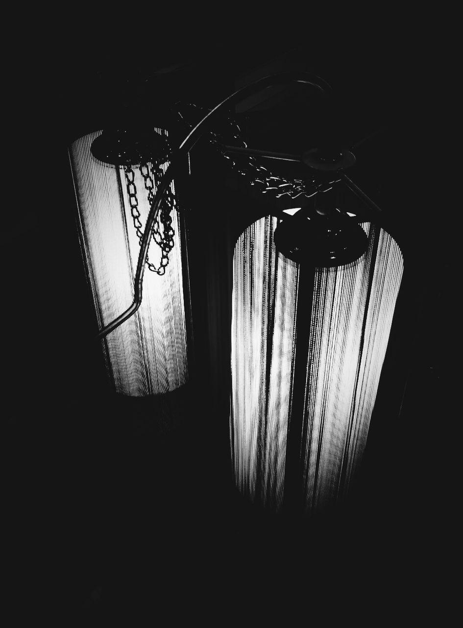 lighting equipment, no people, electricity, indoors, dark, illuminated, low angle view, black background, hanging, lamp shade, night, close-up, technology