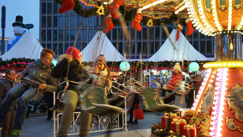 carousel on a christmas market in Berlin, Germany Amusement Park Boys Carousel Children Christmas Market Fun Girls Illuminated Kids Merry Go Round Outdoors