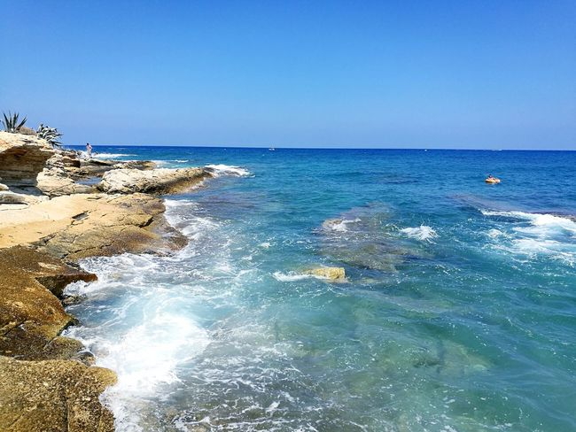 Island Crete Greece Crete Chersonissos Water Wave Sea Clear Sky Beach Blue Sand Summer Sky Horizon Over Water Seascape Rocky Coastline Calm Coast Seashore Rock