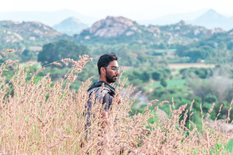 On the rocks.. Beard One Man Only Only Men Adult One Person Adults Only Nature Field People Plant Mountain Outdoors Day Happiness Young Adult Men Landscape Standing One Young Man Only Rural Scene An Eye For Travel