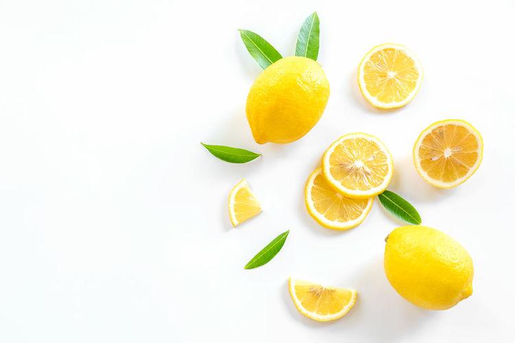 Directly above shot of orange fruits on white background