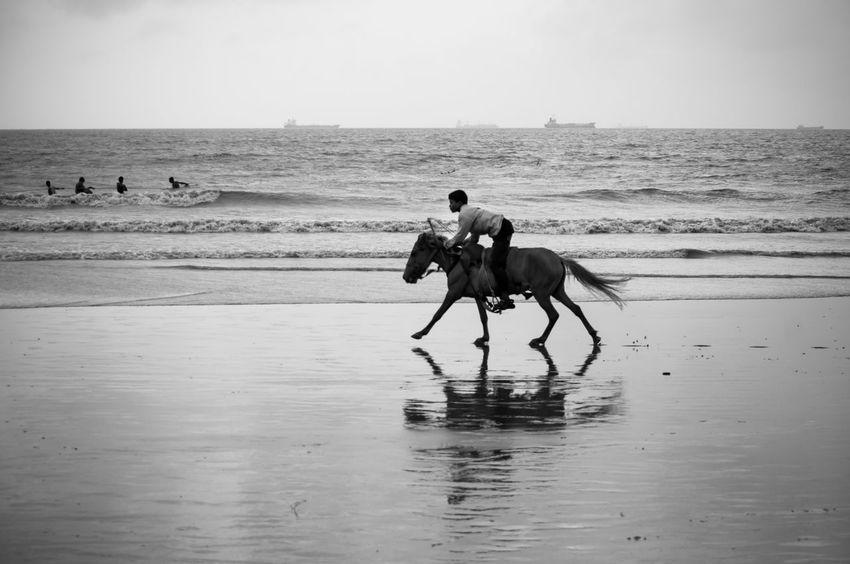 Enjoying horse ride. Beach Horse Riding Blackandwhite Sea Scape Lifestyles Eyeem On Week Eyeemmarket Traveling Bangladesh Travel Photography