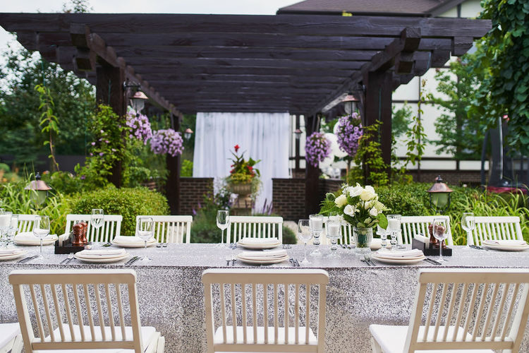 Potted plants on table and chairs at home