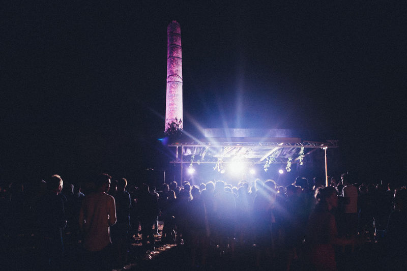 Arts Culture And Entertainment Audience Crowd Enjoyment Event Excitement Festival Fun Group Of People Illuminated Large Group Of People Leisure Activity Lifestyles Light Light - Natural Phenomenon Lighting Equipment Men Music Night Nightlife Performance Real People Stage Stage Light Women