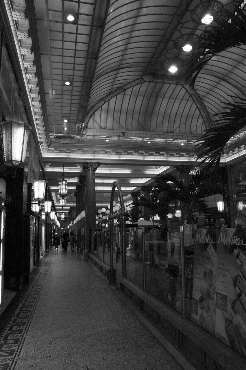 illuminated, ceiling, indoors, the way forward, rail transportation, railroad station platform, railroad station, transportation, real people, built structure, architecture, night