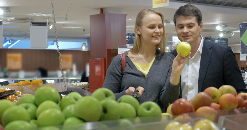 Young woman with fruits in store