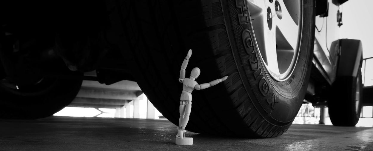 Brakes. Backlit Blackandwhite Brake Close-up Concrete Doll Ground Heavy Heavy Metal Jeep Lines Monochrome Outdoors Parking Garage Pose Rims Statue Sunday Surface Level Tire Tucson Arizona  Weight Weight Of The World Windyday Wooden