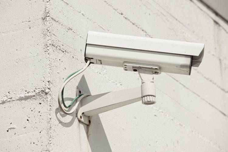 Close-Up Of Security Camera Mounted On Wall