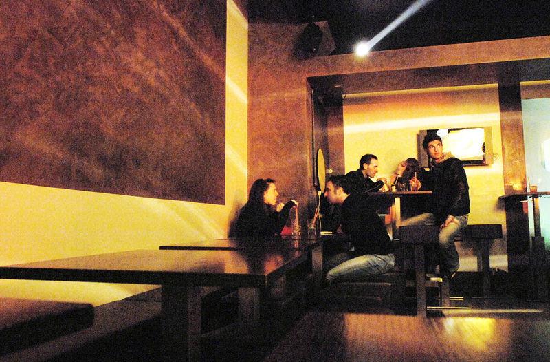 Group of people sitting in the dark room