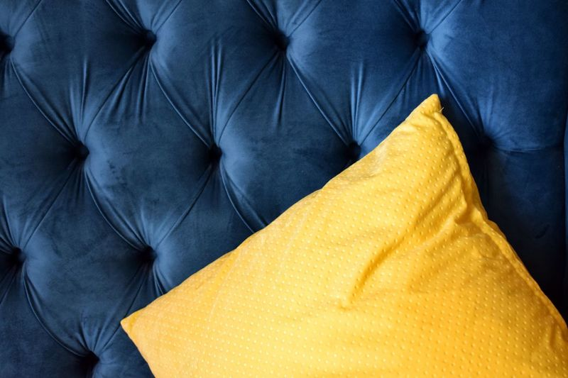 Close-up of yellow pillow on sofa