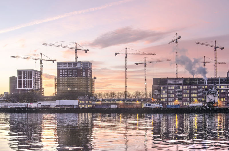 Building Exterior Architecture Built Structure Sky Water Industry Waterfront Nature Sunset Reflection No People Crane - Construction Machinery Cloud - Sky City Outdoors Factory Machinery Construction Industry Building
