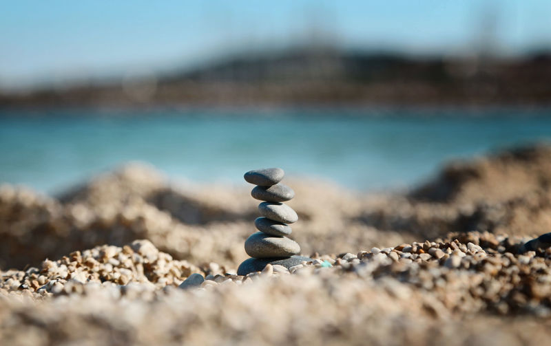 Balance Beach Close-up Day Focus On Foreground Land Nature No People Outdoors Pebble Rock Sand Sea Selective Focus Sky Solid Stack Stone Stone - Object Surface Level Water