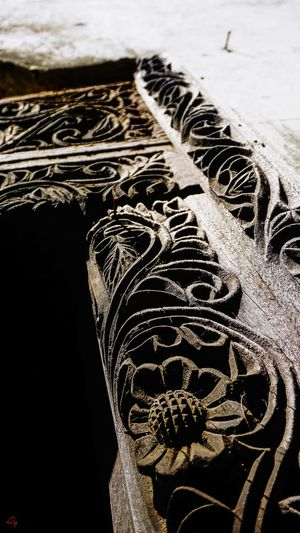 intricate carvings of a Lamu door Swahili Door Carving - Craft Product Wood - Material Floral Floral Pattern Old Close-up