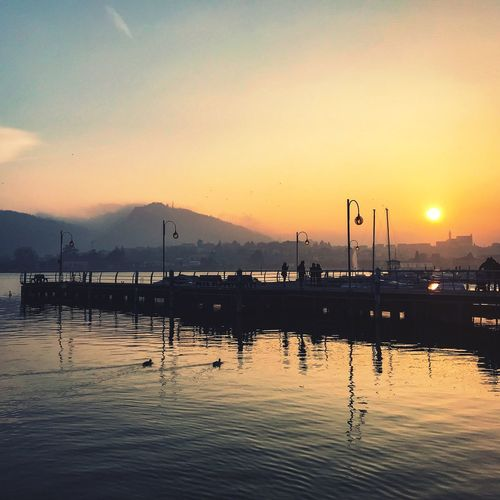 Beautiful sunset in Sarnico, Lago d'Iseo Port Lago D'Iseo Iseo Lake Italy Water Sky Sunset Reflection Silhouette Nature Beauty In Nature Idyllic Outdoors Sun Orange Color Tranquility Tranquil Scene