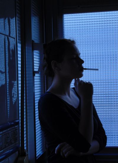 Casual Clothing Cigarette  Contemplation Lifestyle Lifestyles Loneliness Self Portrait Window Woman Portrait Young Adult
