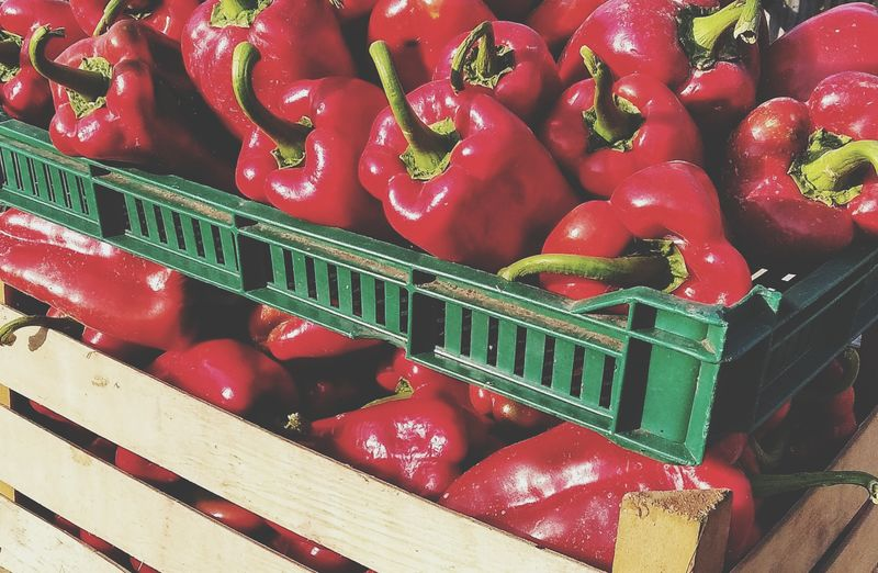 High angle view of red bell peppers in market