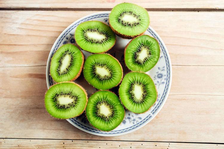 kiwi on plate at wood table. top view EyeEm Best Edits EyeEm Best Shots EyeEmBestPics EyeEmNewHere Food And Drink Healty Food Fruit Fruits Healthy Healthy Eating Healthy Lifestyle Healthyfood Kiwi Kiwi - Fruit Kiwifruit Vitamin