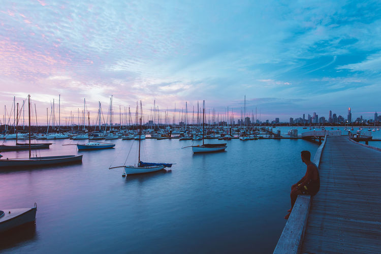 Scenic view of harbor against sky during sunset