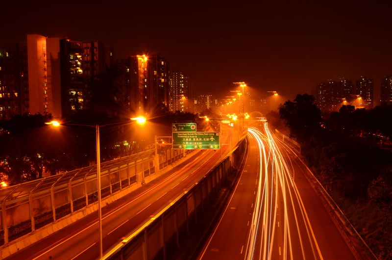 High angle view of light trails on two lane highway during night