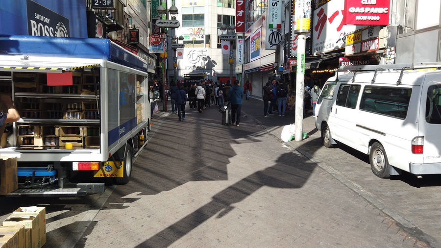 Urban Winter Street City Shibuya Tokyo Japan Shibuya Center-gai Mode Of Transportation Transportation Land Vehicle Motor Vehicle Architecture Public Transportation Car City Life Building Exterior Built Structure Incidental People Road City Street Sunlight Bus Communication Real People Group Of People Outdoors