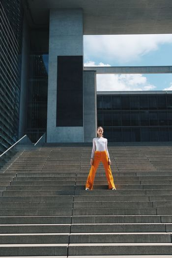 Full length of woman walking on staircase of building