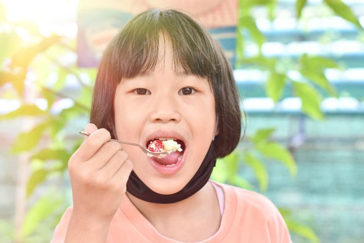 Portrait of boy eating food