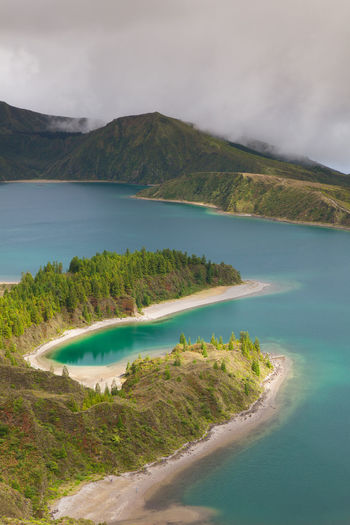 Caldera Lago di Fogo - lake on Sao Miguel Island, Azores, Portugal Azores Islands Caldera Crater Lake Beach Beauty In Nature Cloud - Sky Crater Deep Fog Idyllic Lago Di Fogo Land Mist Mountain Mountain Range Nature No People Non-urban Scene Samo Muguel Scenics - Nature Steep Sunset Volcano Water