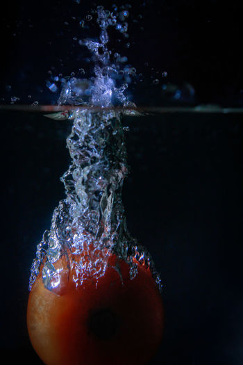 Close-up of splashing water against black background