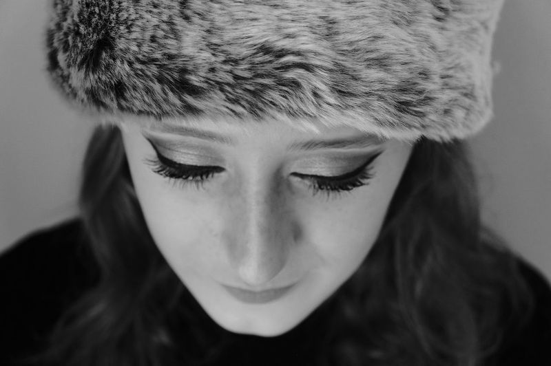 Close-Up Of Young Woman Wearing Fur Hat