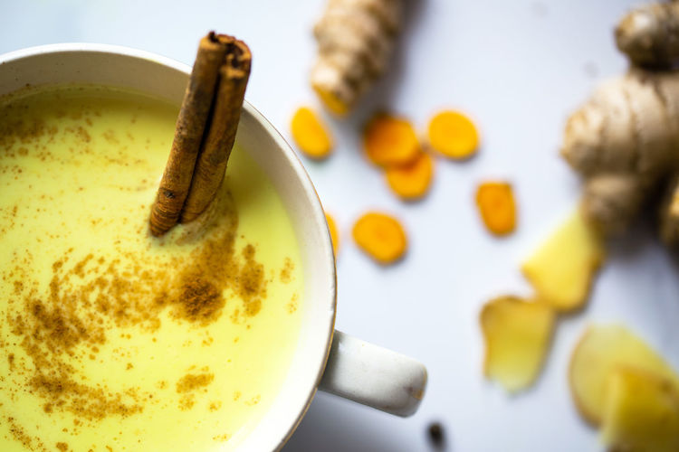 Golden milk Food And Drink Drink Mug Cup Coffee Cup Food Indoors  Still Life Close-up Freshness Hot Drink No People Crockery Golden Milk Tumeric Tumeric Root Ginger Spices Yellow Yellow Color Cinnamon Cinnamon Sticks Marble Healthy Food Healthy Lifestyle