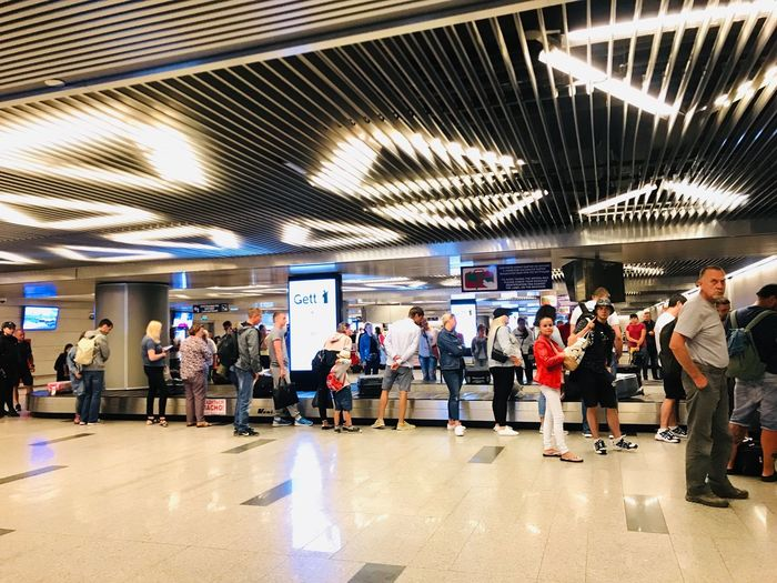 Waiting for Luggage at the airport Group Of People Crowd Large Group Of People Real People Transportation Men Architecture Women Indoors  Public Transportation Ceiling Mode Of Transportation Illuminated Subway Station Travel Built Structure Communication Lifestyles Waiting Adult