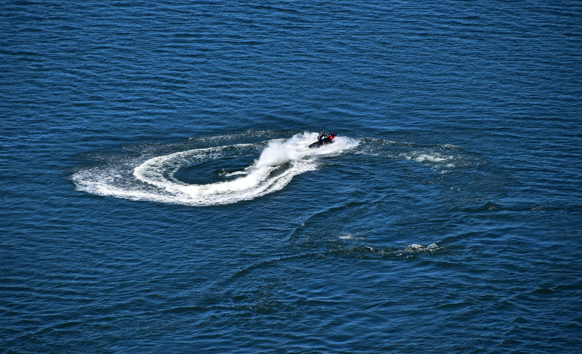 High angle view of person jet boating on sea