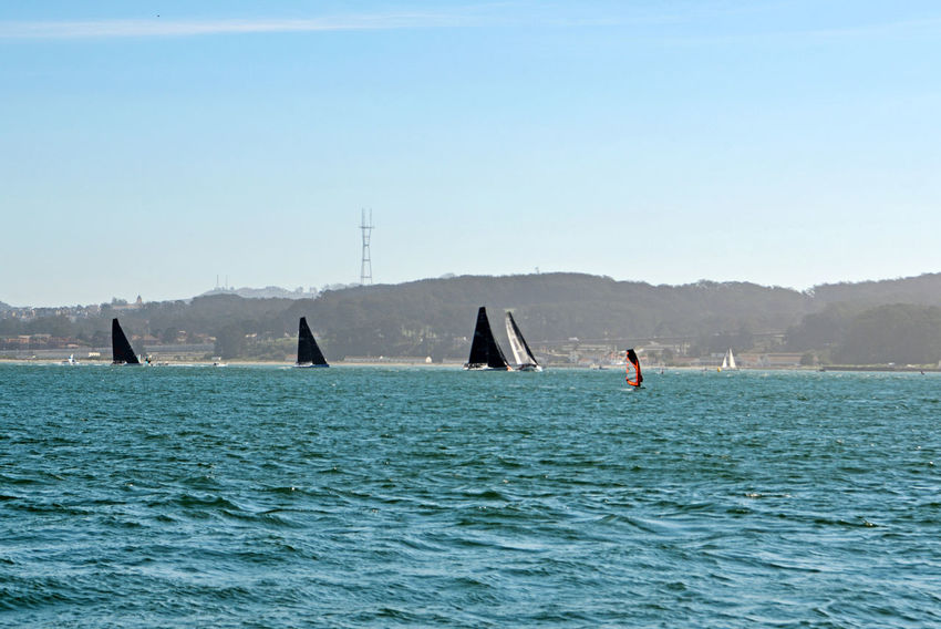 Yachts Racing On San Francisco Bay 1 San Francisco CA🇺🇸 The Color Of Sport Oracle Team USA 50 Ft Foiling Catamarans 24-meter- High Wingsail Capable Of Speeds Surpassing 55 Mph Training The 35th Anerica's Cup San Francisco Bay Hills Of San Francisco Sutro Tower Bayview Aboard The Alma 80 Ft. Scow Schooner Sailing Tacking Watersports State Of The Art Sailing Technology Cityscapes Landscape_Collection Landscape_photography